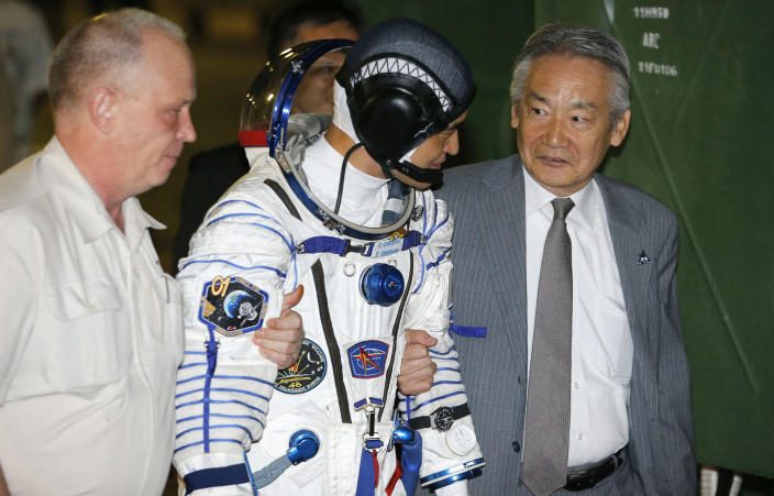 <p>Japanese astronaut Takuya Onishi, member of the main crew of the mission to the International Space Station (ISS), walks to the rocket prior the launch at the Russian leased Baikonur cosmodrome, Kazakhstan, Thursday, July 7, 2016. (AP Photo/Dmitri Lovetsky, Pool) </p>