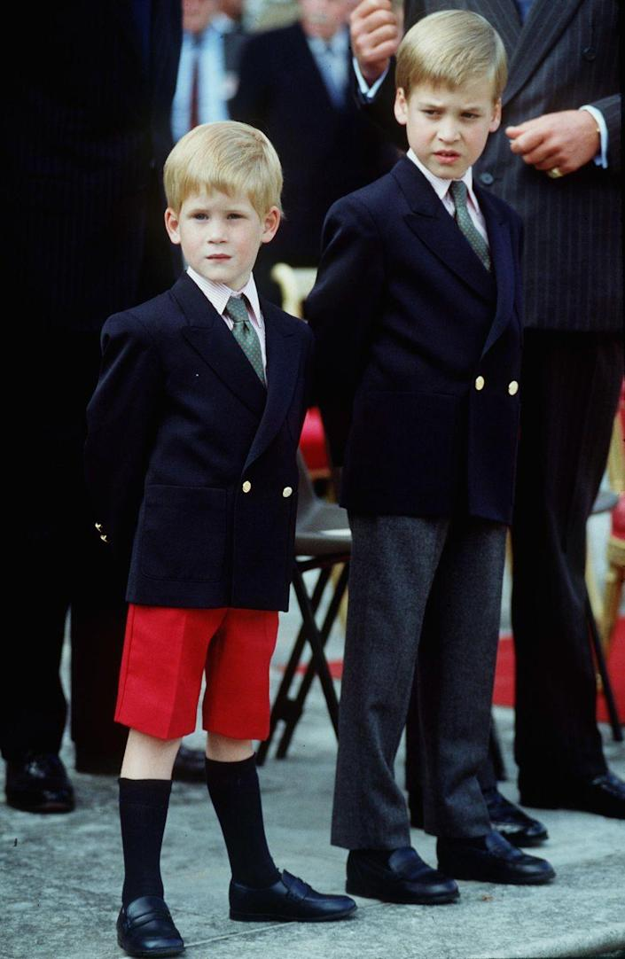 <p>A 4-year-old Harry and brother William—not Prince George, despite what your eyes may lead you to believe— attend their first official royal engagement at the Beating the Retreat Parade not far from home at Kensington Palace. </p>