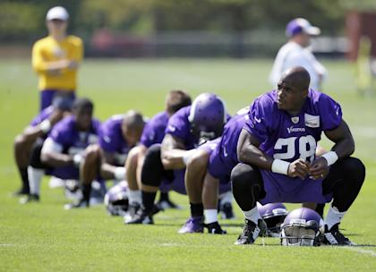Adrian Peterson is on paid leave until his legal case reaches a resolution. (AP)