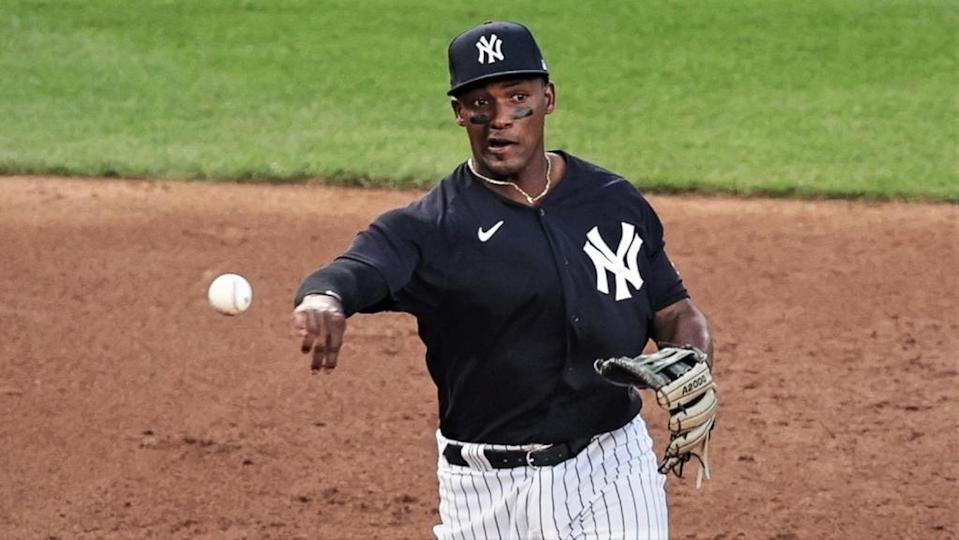 Miguel Andujar makes a throw to first base