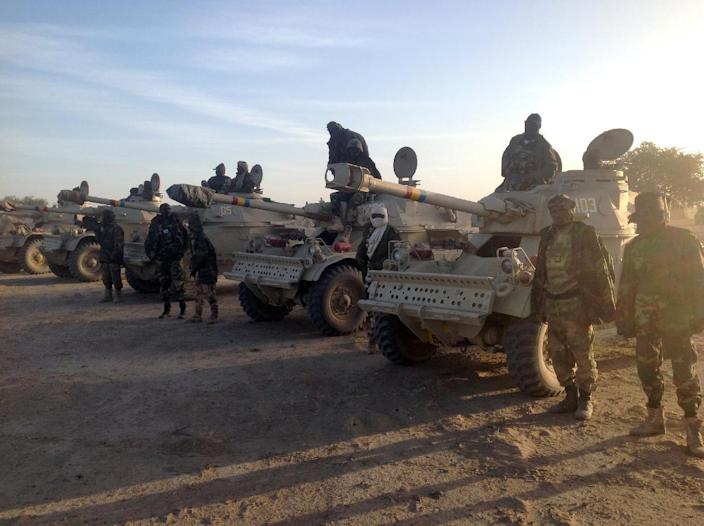 Chadian soldiers stand next to their armoured vehicles on January 21, 2015, at the border between Nigeria and Cameroon (AFP Photo/Ali Kaya)