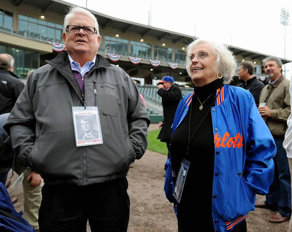 Jim Crockett, Jr. and Frances Crockett mingle with other former Charlotte O's personnel outside the Charlotte Knights dugout at BB&T BallPark in Charlotte, NC on Friday, April 18, 2014.