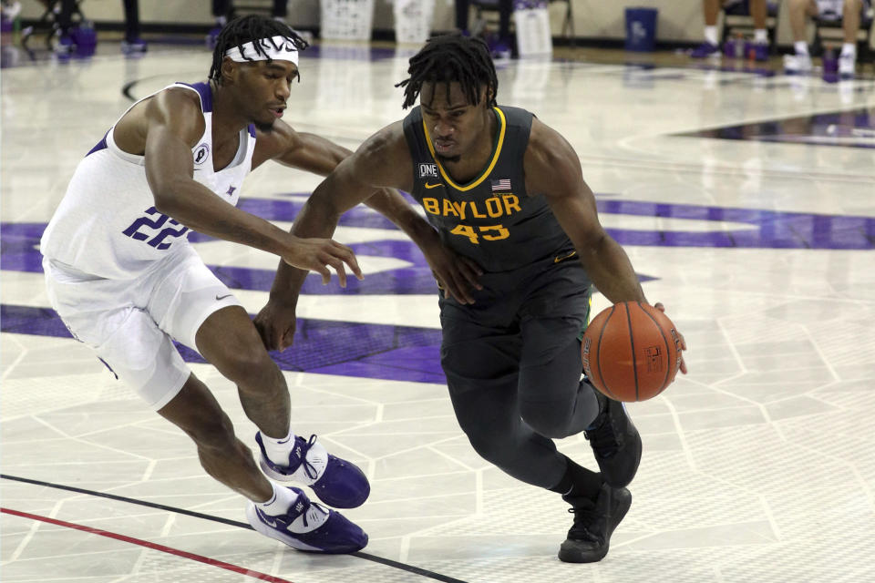 File-TCU guard RJ Nembhard (22) defends as Baylor guard Davion Mitchell (45) drives the ball past during a men's NCAA college basketball game, Saturday, Jan. 9, 2021. Mitchell and MaCio Teague, two of the leagues best shooters, were part of a Big 12-record 23-game winning streak last season in their debuts as Baylor starters. Those former transfers had also gone through a redshirt season together. (AP Photo/ Richard W. Rodriguez, File)