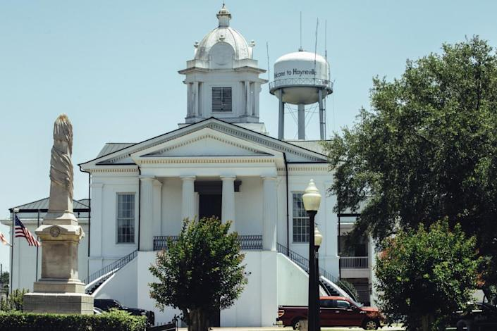 The Tuskegee Confederate Memorial monument stands across from the Lowndes county courthouse in Hayneville, Alabama.