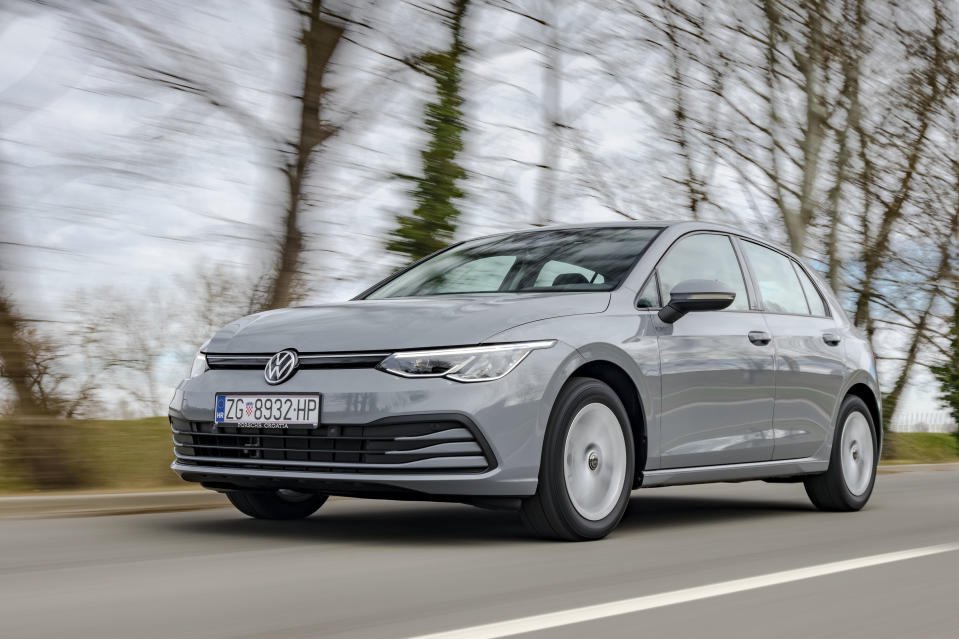 Zagreb, Croatia - March 9, 2020: Man is driving new Volkswagen Golf fast on a country road. The 8th generation of iconic VW model is based on updated version of the MQB platform.
