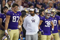 Washington head coach Jimmy Lake, center, stands with teammates on the sidelines against Montana late in the second half of an NCAA college football game Saturday, Sept. 4, 2021, in Seattle. Montana won 13-7. (AP Photo/Elaine Thompson)