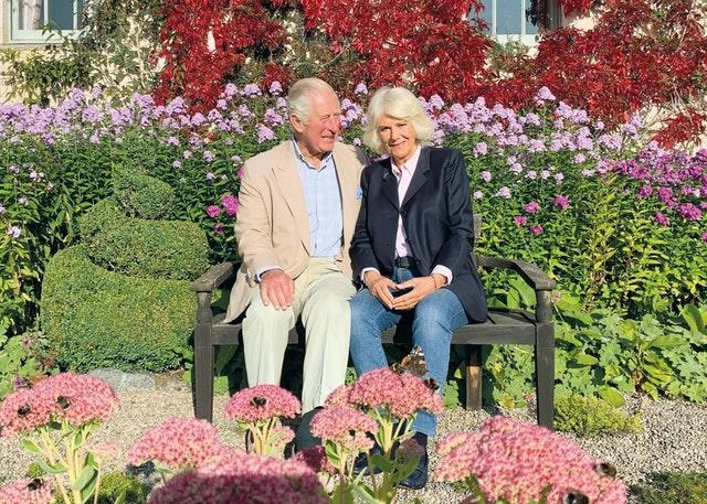 Charles and Camilla, pictured in a garden at Birkhall, will spend Christmas at their Gloucestershire home. The Prince of Wales and The Duchess of Cornwall/Clarence House