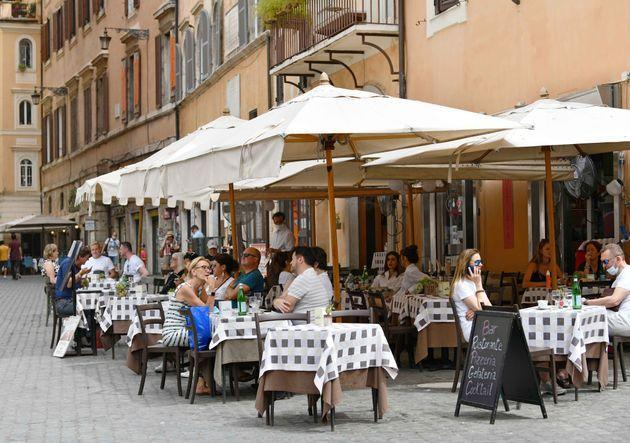 People sit on the terrace of a restaurant in Rome, Italy, on June 24, 2021. As of next week, Italy is preparing to lift the outdoor face mask mandate as the country's main COVID-19 indicators appear to have stabilized. (Photo by Jin Mamengni/Xinhua via Getty Images) (Photo: Xinhua News Agency via Xinhua News Agency via Getty Ima)