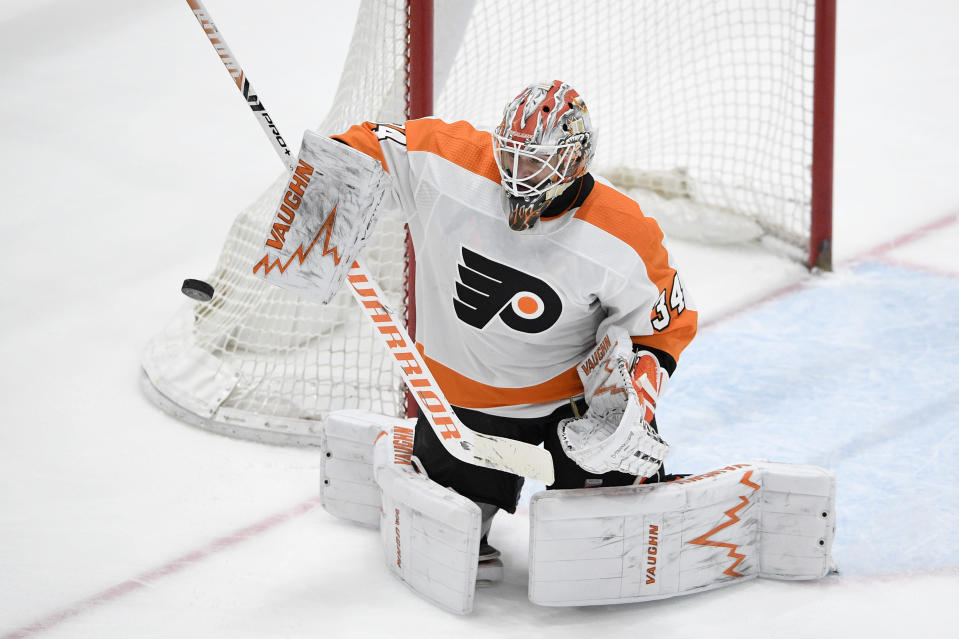 Philadelphia Flyers goaltender Alex Lyon defends the net during the third period of the team's NHL hockey game against the Washington Capitals, Saturday, May 8, 2021, in Washington. The Capitals won 2-1 in overtime. (AP Photo/Nick Wass)