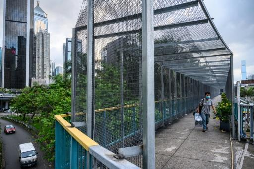 Pedestrian bridges over busy roads are clad in metal cages after protesters distrupted highways by throwing objects from above