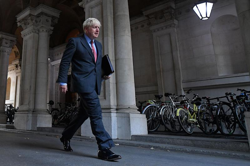 Britain's Prime Minister Boris Johnson walks to Downing Street in central London on September 22, 2020 after attending the weekly meeting of the cabinet at the Foreign, Commonwealth and Development Office (FCDO). - The UK government will on Tuesday announce new measures to curb rising coronavirus cases across England, hours after upgrading the virus alert level with top advisers warning of a surging death toll within two months without immediate action. (Photo by JUSTIN TALLIS / AFP) (Photo by JUSTIN TALLIS/AFP via Getty Images)