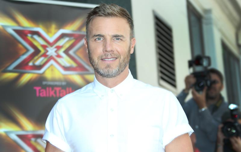 X Factor UK judge Gary Barlow arrives at the Mayfair Hotel in central London, Thursday, Aug 29, 2013. (Photo by Joel Ryan/Invision/AP)