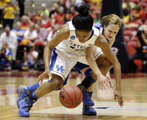 Kentucky guard Bria Goss, left, fights for a loose ball with McNeese State guard Caitlyn Baggett during the second half of an NCAA tournament first-round women's college basketball game, Saturday, March 17, 2012, in Ames, Iowa. (AP Photo/Charlie Neibergall)