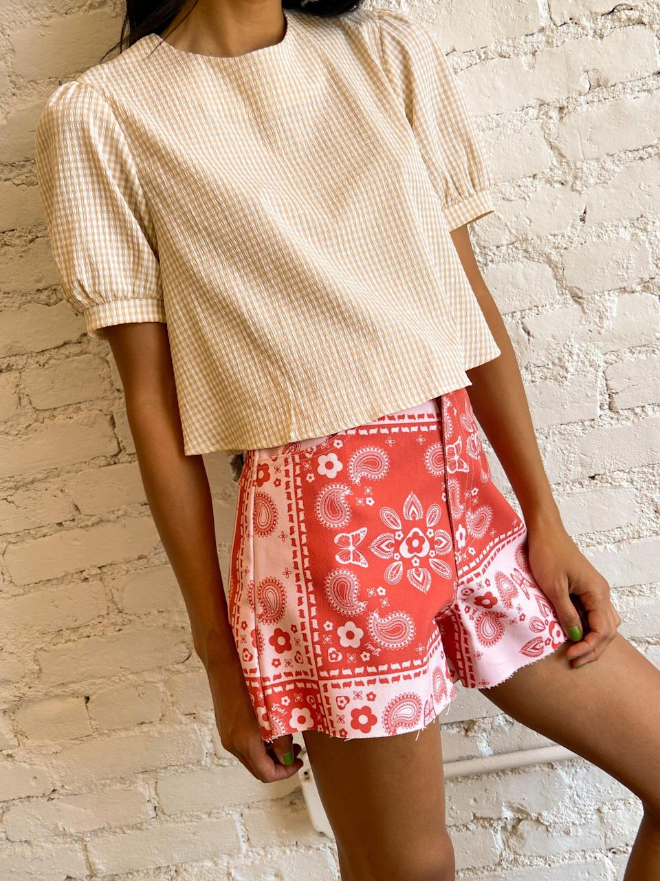 """<br><br><strong>Lisa Says Gah</strong> Blanca Top, Tuscany Gingham, $, available at <a href=""""https://go.skimresources.com/?id=30283X879131&url=https%3A%2F%2Flisasaysgah.com%2Fcollections%2F30-off-tops%2Fproducts%2Fblanca-top-tuscany-gingham"""" rel=""""nofollow noopener"""" target=""""_blank"""" data-ylk=""""slk:Lisa Says Gah"""" class=""""link rapid-noclick-resp"""">Lisa Says Gah</a>"""