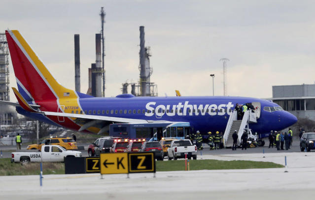 <p>A Southwest Airlines plane sits on the runway at the Philadelphia International Airport after it made an emergency landing in Philadelphia, on Tuesday, April 17, 2018. (Photo: David Maialetti/The Philadelphia Inquirer via AP) </p>
