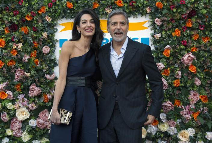 ONE USE ONLY George and Amal Clooney, representing the Clooney Foundation for Justice, arrive at the People's Postcode Lottery charity gala at the McEwan Hall in Edinburgh. (Photo by David Cheskin/PA Images via Getty Images)