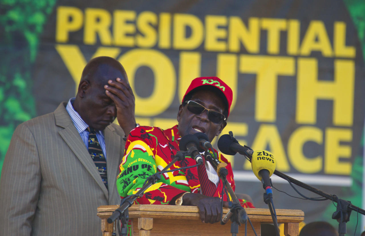 Zimbabwe's President Robert Mugabe addresses party supporters at a rally in Lupane about 170 Kilometres north of Bulawayo, Zimbabwe, Friday, July 21, 2017. Mugabe's rally is his first since his return from a routine medical review in Singapore. The world's oldest leader has launched a series of rallies targeting the youth ahead of Presidential elections set for 2018. (AP Photo/Tsvangirayi Mukwazhi)