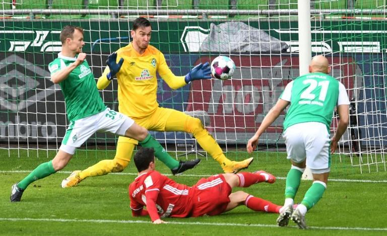 Bayern Munich striker Robert Lewandowski (C, bottom) scored and hit the woodwork three times at Werder Bremen on Saturday