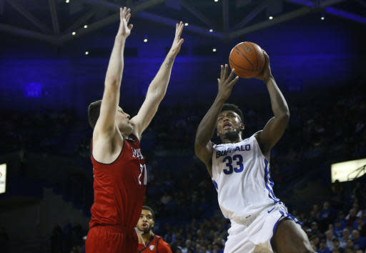 Buffalo forward Nick Perkins (33) shoots as Miami of Ohio forward Aleks Abrams (21) defends during the first half of an NCAA college Basketball game, Saturday, Jan. 12, 2019, in Buffalo N.Y. (AP Photo/Jeffrey T. Barnes)