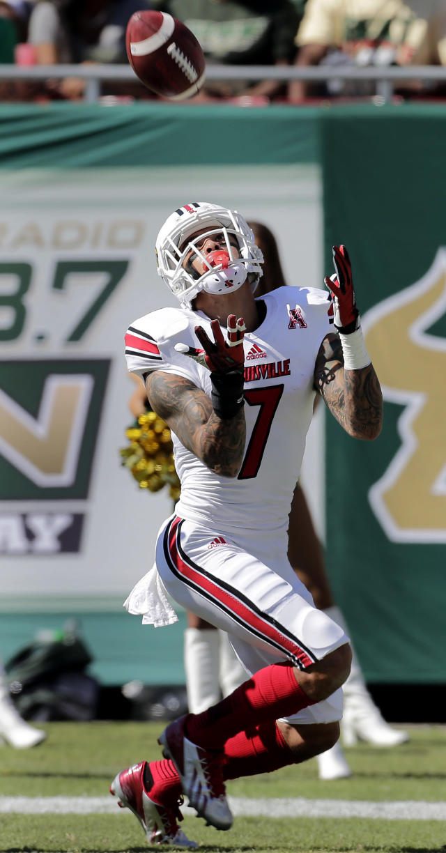 Louisville wide receiver Damian Copeland (7) pulls in a 20-yard touchdown reception during the first quarter of an NCAA college football against South Florida game Saturday, Oct. 26, 2013, in Tampa, Fla. (AP Photo/Chris O'Meara)