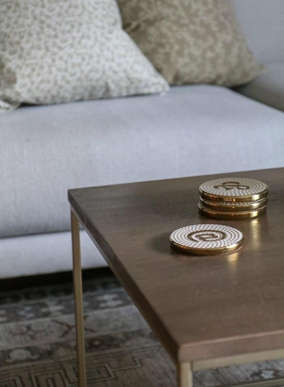 <p>These <span>Effortless Composition Gold and White Social Coasters</span> ($25 for four) are too cute. They are the perfect gift for someone who loves home decor.</p>