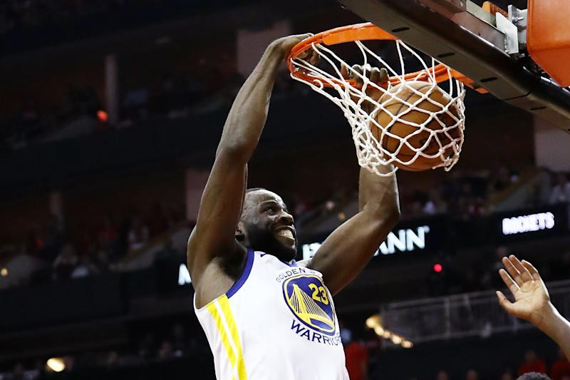 Draymond Green #23 of the Golden State Warriors dunks against Clint Capela #15 of the Houston Rockets in the third quarter of Game Five of the Western Conference Finals of the 2018 NBA Playoffs at Toyota Center on May 24, 2018 in Houston, Texas.