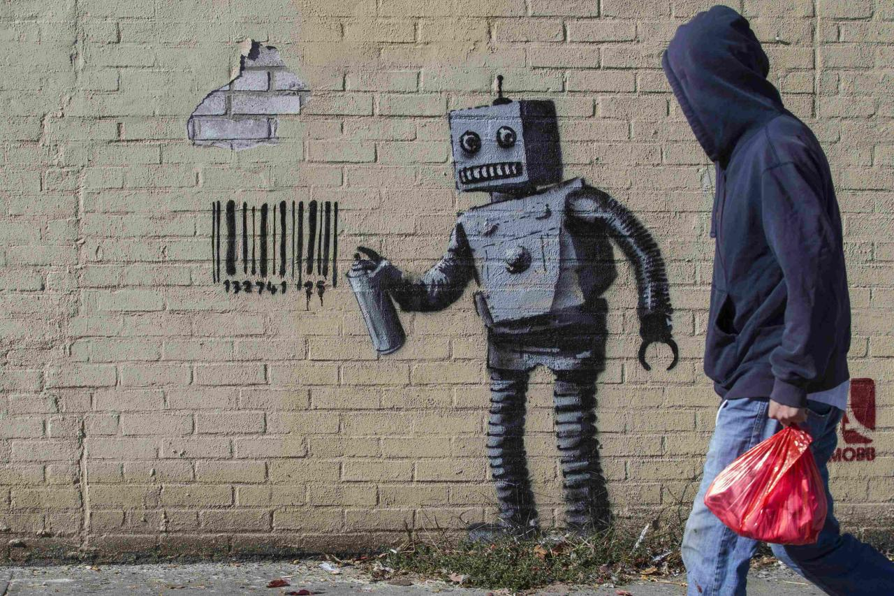 The newest art installation by British artist Banksy, a robot and a barcode, is seen on a wall in the Coney Island area of New York City, October 28, 2013. Famously jaded New Yorkers are getting swept up in the hype over Banksy, the renegade graffiti artist who is leaving his mark across the city this month. REUTERS/Brendan McDermid (UNITED STATES - Tags: SOCIETY)