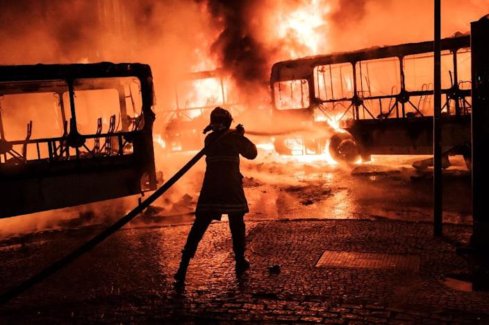 A peaceful protest by several thousand in central Rio turned violent, with small groups setting fires, including torching at least eight buses (AFP Photo/YASUYOSHI CHIBA)