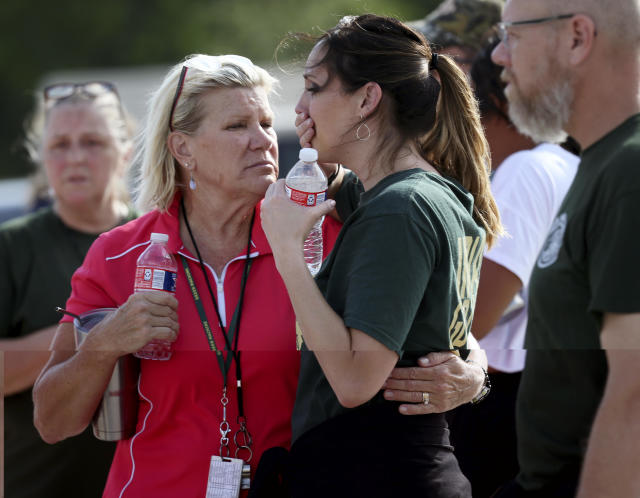 <p>Santa Fe High School staff react as they gather in the parking lot of a gas station following a shooting at the school in Santa Fe, Texas, on Friday, May 18, 2018. (Photo: Jennifer Reynolds/The Galveston County Daily News via AP) </p>
