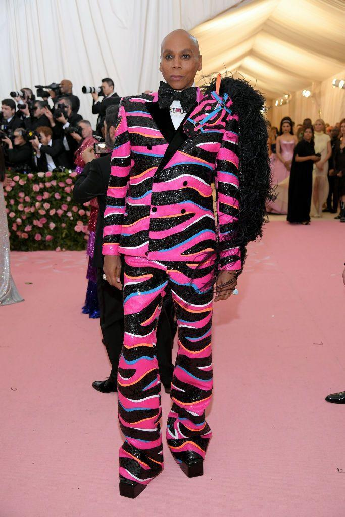 <p>Ru looked phenomenal in this hot pink, zebra-striped suit, with some feathers and sparkle for the last Met Gala pre-pandemic shutdown. </p>