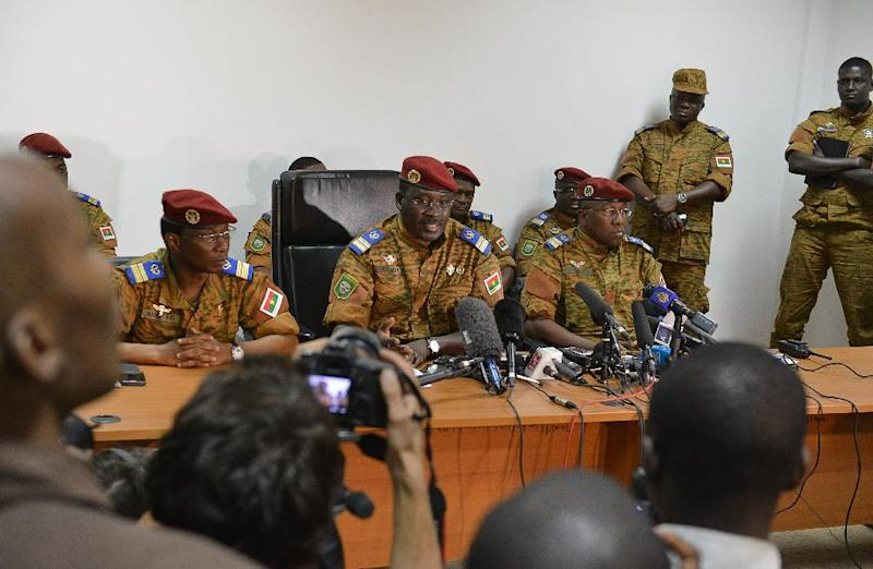 Isaac Zida (C), named by Burkina Faso's army as interim leader, speaks during a press conference on November 6, 2014 in Ouagadougou