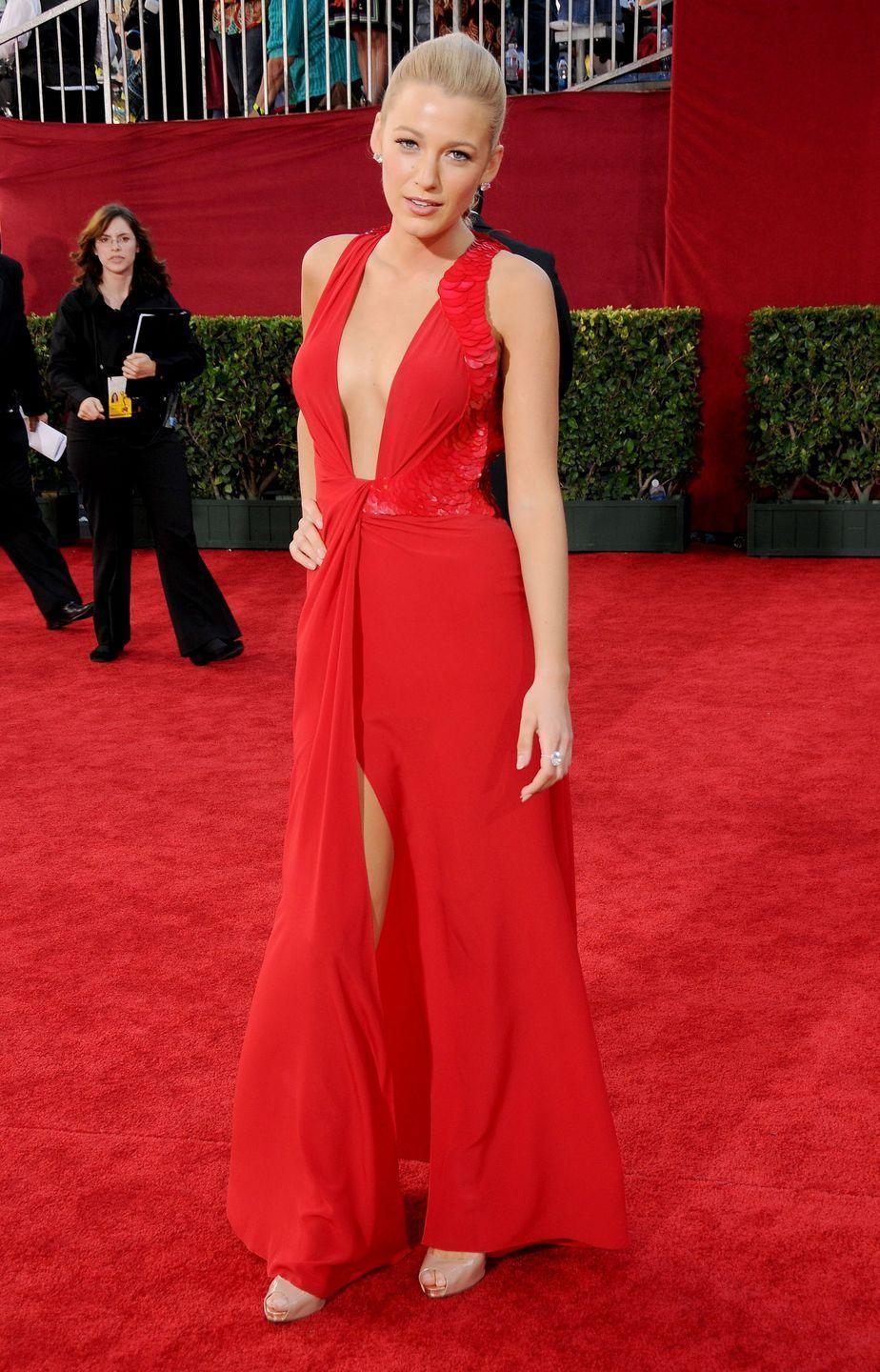<p>Lively wore this red dress with a deep plunging neckline on the Emmy red carpet in 2009.</p>