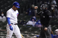 Chicago Cubs' Willson Contreras walks to the dugout after striking out swinging during the ninth inning of a baseball game against the Atlanta Braves in Chicago, Sunday, April 18, 2021. (AP Photo/Nam Y. Huh)