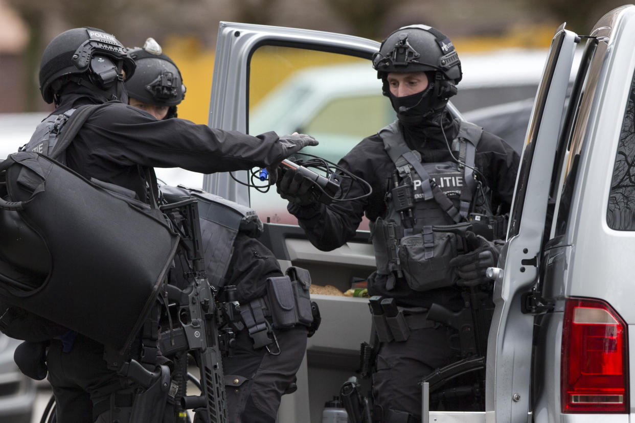 Dutch counter terrorism police prepare to enter a house after a shooting incident in Utrecht, Netherlands, Monday, March 18, 2019. (Photo: Peter Dejong/AP)
