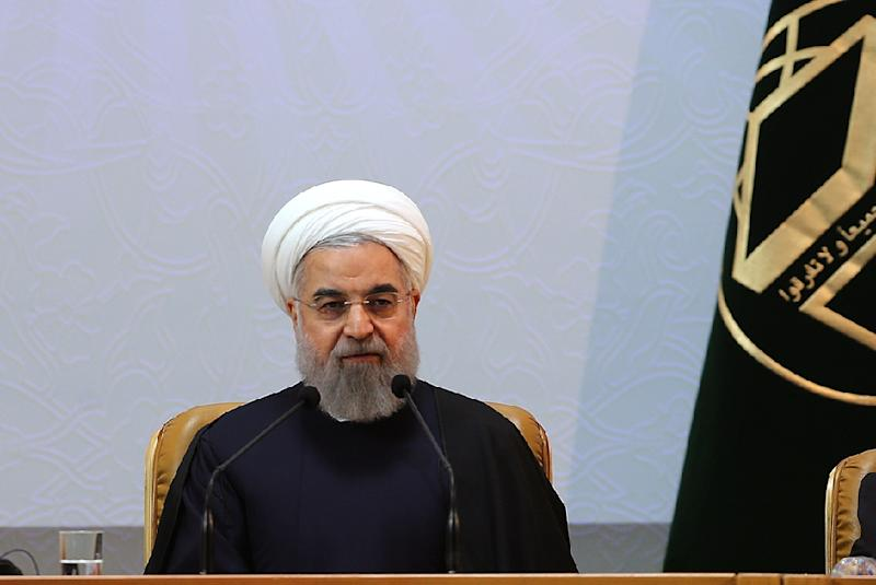 Hassan Rouhani says Muslim countries should strive to improve the world's opinion of Islam (AFP Photo/)