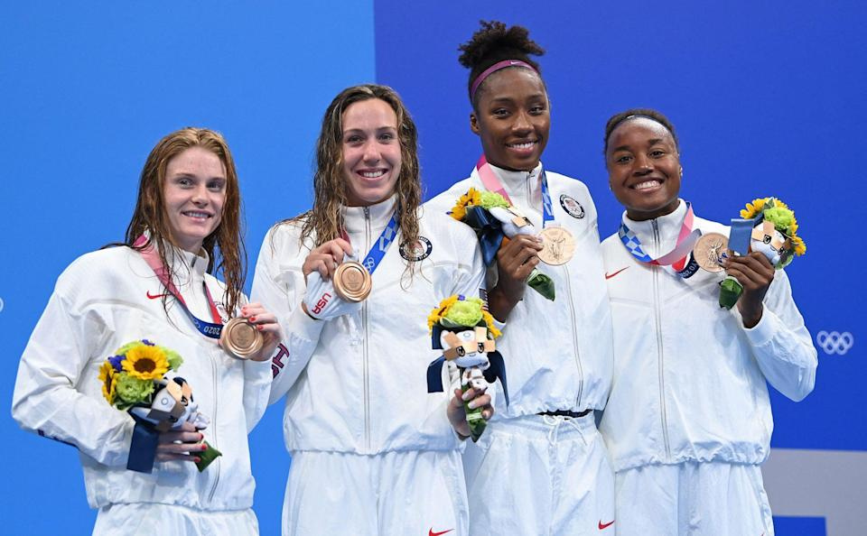 """<p>Biography (from left): Brown, 22, is from Tennessee making her Olympic debut; Weitzeil is a 24-year-old from California who won two medals in the 2016 Games; Hinds, 27, from Texas, is making her Olympic debut; and fellow Texas native Manuel, 24, won four previous medals at 2016 Olympics</p> <p>Event: Women's 4x100m freestyle relay (swimming)</p> <p>Quote: Manuel, who <a href=""""https://www.nbcolympics.com/news/defending-olympic-champion-simone-manuel-misses-out-100m-free-final-trials"""" rel=""""nofollow noopener"""" target=""""_blank"""" data-ylk=""""slk:had struggled"""" class=""""link rapid-noclick-resp"""">had struggled</a> in qualifying for Team USA, said, """"Even though the last couple of months have not been the greatest for me, I've trained really hard the past four-and-a-half, five years. So eventually that hard work will show up.""""</p>"""