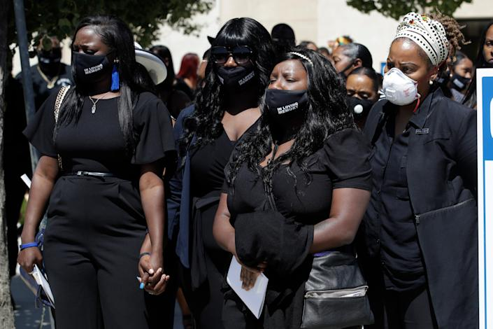 Relatives huddle outside the site of a funeral for Robert Fuller on Tuesday, June 30, 2020, in Littlerock, Calif. Fuller, a 24-year-old Black man, was found hanging from a tree in a park in a Southern California high desert city. Authorities initially said the death of Fuller appeared to be a suicide but protests led to further investigation, which continues.