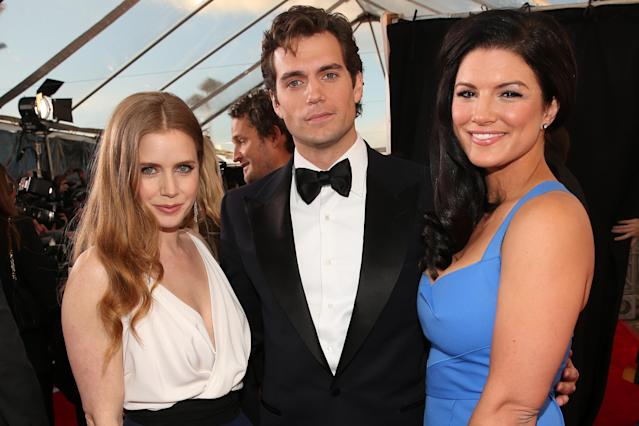 SANTA MONICA, CA - JANUARY 10: (L-R) Actors Amy Adams, Henry Cavill and Gina Carano attend the 18th Annual Critics' Choice Movie Awards held at Barker Hangar on January 10, 2013 in Santa Monica, California. (Photo by Christopher Polk/Getty Images for BFCA)