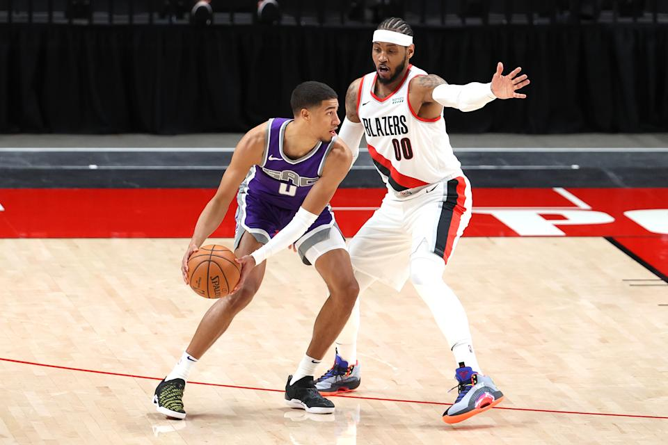 Sacramento Kings rookie Tyrese Haliburton works against Portland Trail Blazers forward Carmelo Anthony during their preseason game.