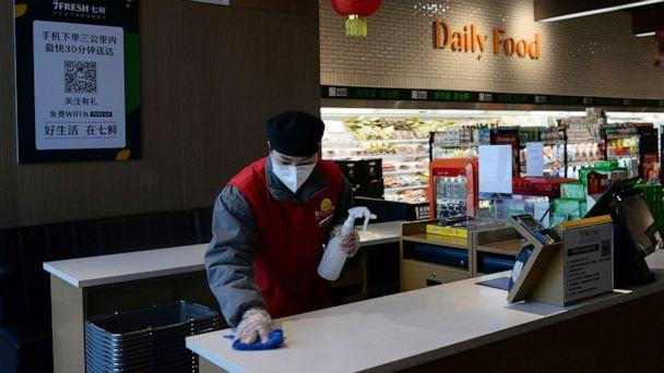 PHOTO: A staff member cleans a check counter at a JD.com's 7Fresh chain before the store opens, during an outbreak of the novel coronavirus, in Yizhuang town, Beijing, Feb. 8, 2020. (Tingshu Wang/Reuters)
