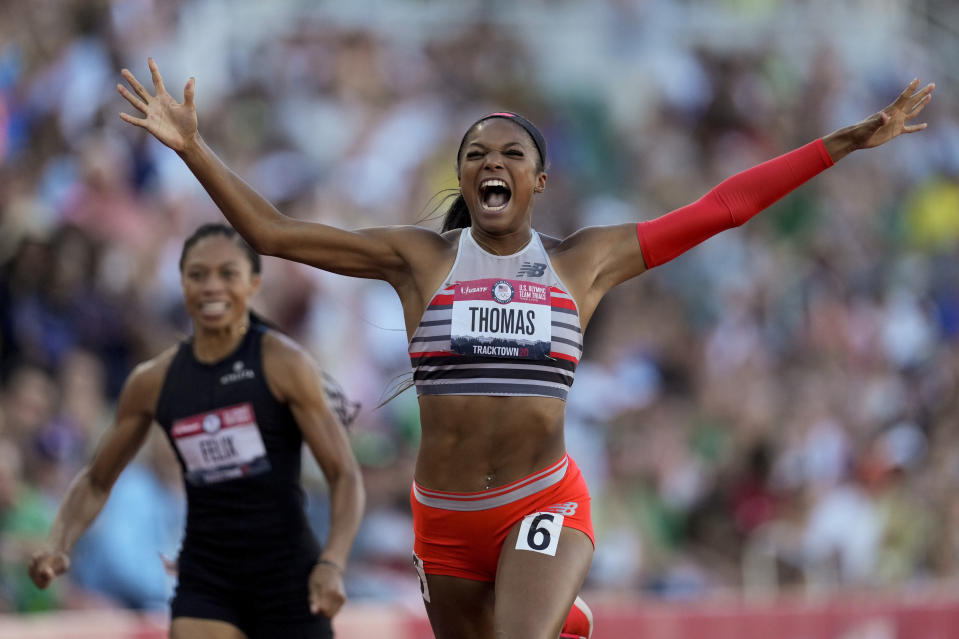 FILE - In this June 26, 2021, file photo, Gabby Thomas celebrates after winning the final in the women's 200-meter run at the U.S. Olympic Track and Field Trials in Eugene, Ore. Harvard-educated sprinter Thomas could make headlines in the 200 at the upcoming Tokyo Games. (AP Photo/Ashley Landis, File)