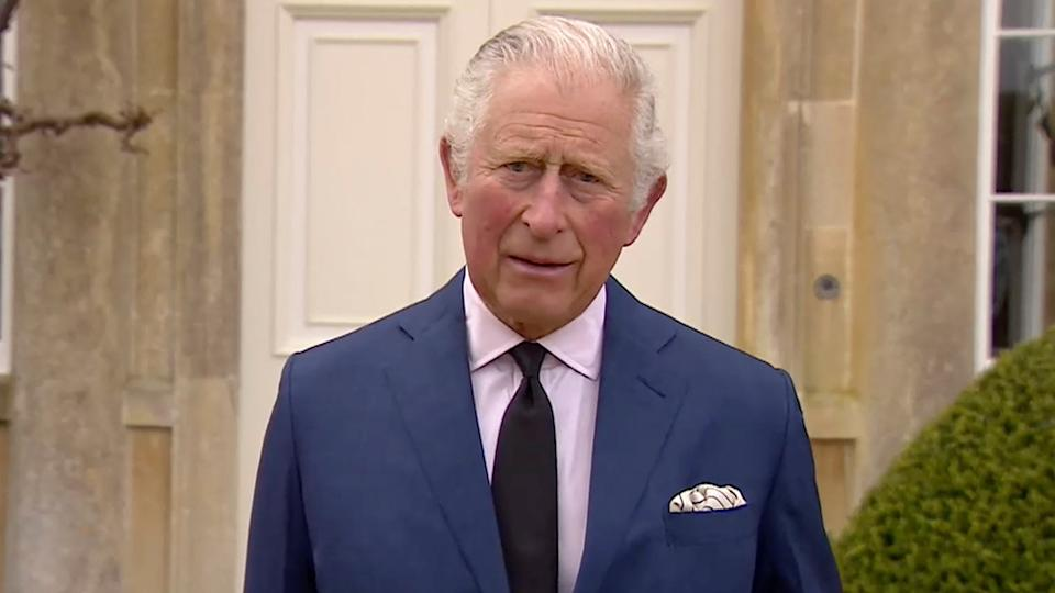 Prince Charles outside his home wearing a black tie