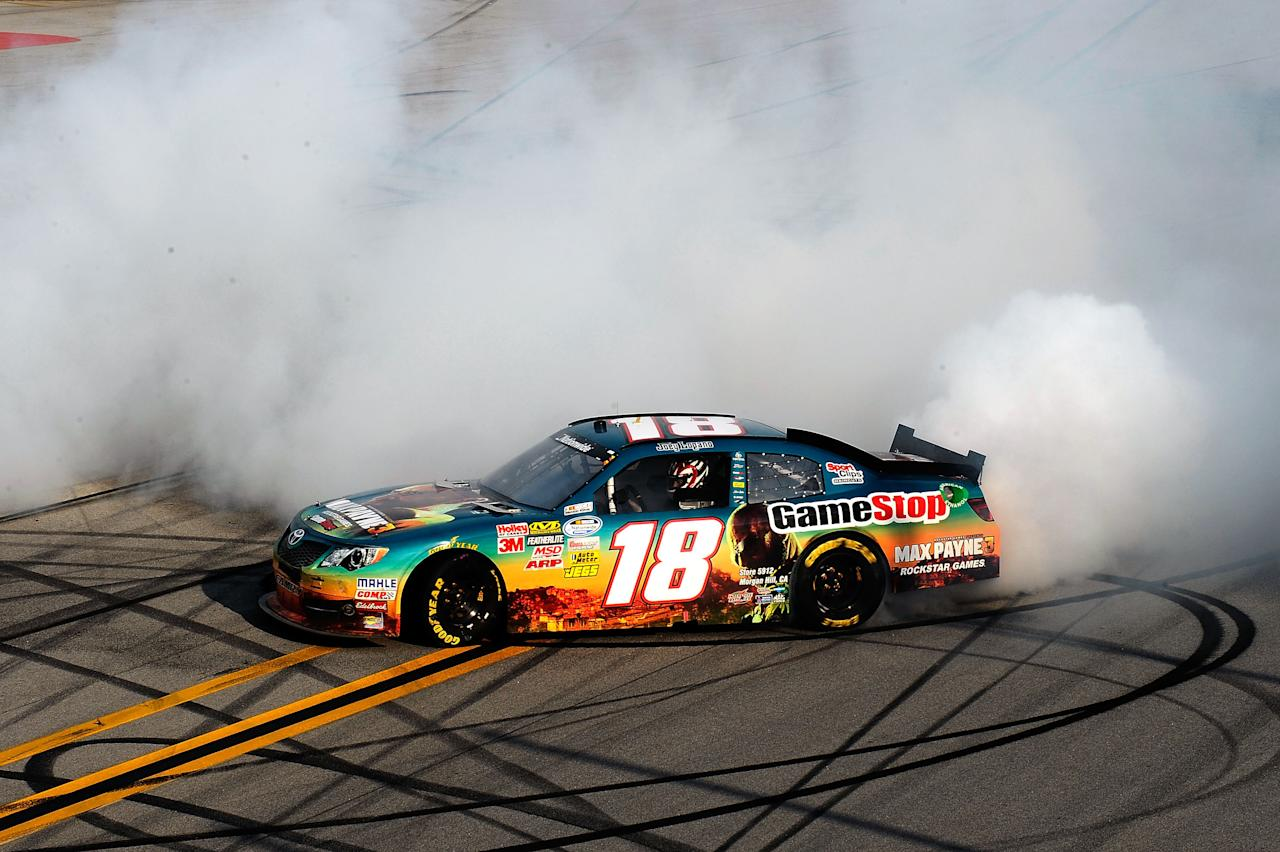 TALLADEGA, AL - MAY 05:  Joey Logano, driver of the #18 GameStop Toyota, burns out to celebrate winning the NASCAR Nationwide Series Aaron's 312 at Talladega Superspeedway on May 5, 2012 in Talladega, Alabama.  (Photo by Jared C. Tilton/Getty Images)