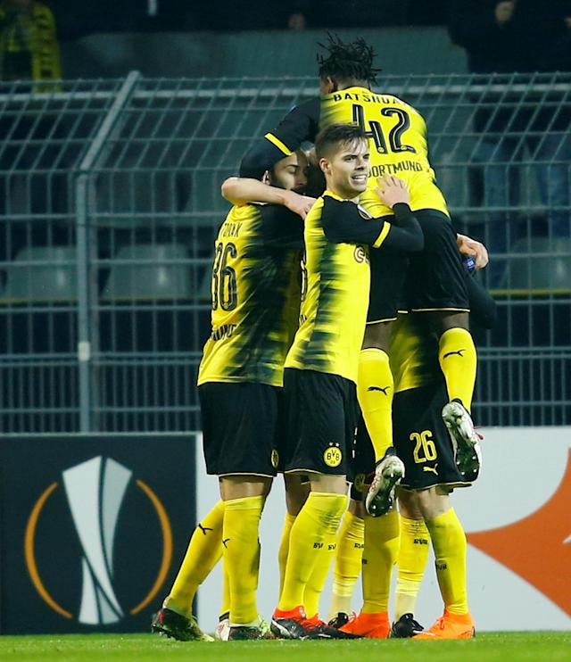 Soccer Football - Europa League Round of 32 First Leg - Borussia Dortmund vs Atalanta - Signal Iduna Park, Dortmund, Germany - February 15, 2018 Borussia Dortmund's Andre Schurrle celebrates scoring their first goal with teammates REUTERS/Leon Kuegeler