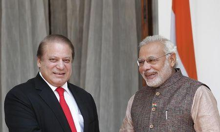 India's Prime Minister Modi and his Pakistani counterpart Sharif smile before the start of their bilateral meeting in New Delhi