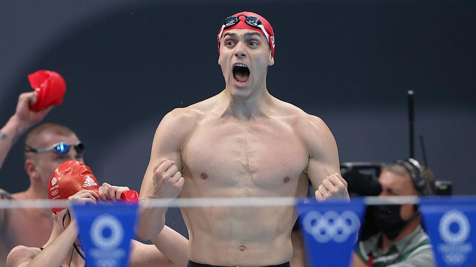 Seen here, Britain's James Guy celebrates a gold in the mixed medley relay.