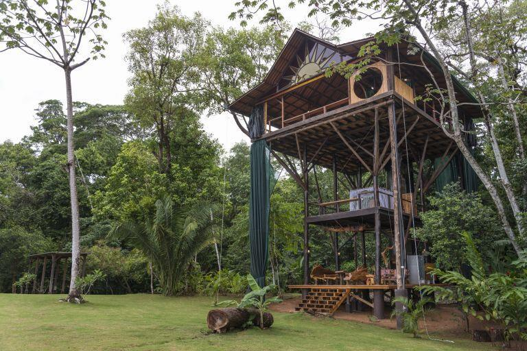 """<p>A woman went off the grid for three years to <a href=""""http://elledecor.com/life-culture/a8292/why-i-gave-up-my-job-to-move-to-costa-rica-and-build-a-treehouse/"""" rel=""""nofollow noopener"""" target=""""_blank"""" data-ylk=""""slk:build her dream home"""" class=""""link rapid-noclick-resp"""">build her dream home</a>. The result? A multi-level bungalow where you can sleep next to birds and monkeys.</p><p> <a class=""""link rapid-noclick-resp"""" href=""""https://www.airbnb.com/rooms/1877004?irgwc=1&irclid=QQjWtNQPnxyOUACwUx0Mo36DUkiRdMXVQ18wVQ0&ircid=4273&sharedid=elledecor.com&af=49497874&iratid=9627&c=.pi73.pk4273_10078&source_impression_id=p3_1595366359_5B0cTZoeieL2lsjj&guests=1&adults=1"""" rel=""""nofollow noopener"""" target=""""_blank"""" data-ylk=""""slk:Book Now"""">Book Now</a> <strong><em>Huge Treehouse in the Jungle</em></strong><br></p>"""