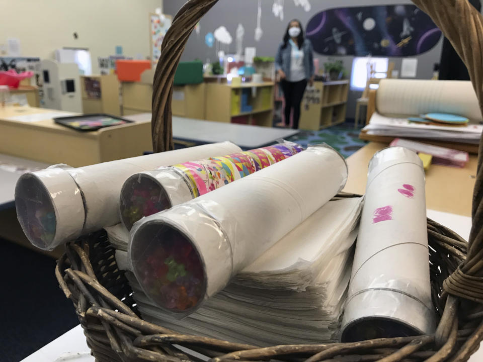 This May 4, 2021 image shows some of the kaleidoscopes made by pre-K students at Cuidando Los Ninos in Albuquerque, N.M. The charity provides housing, child care and financial counseling for mothers, all of whom will benefit from expanded Child Tax Credit payments that will start flowing in July to roughly 39 million households. (AP Photo/Susan Montoya Bryan)