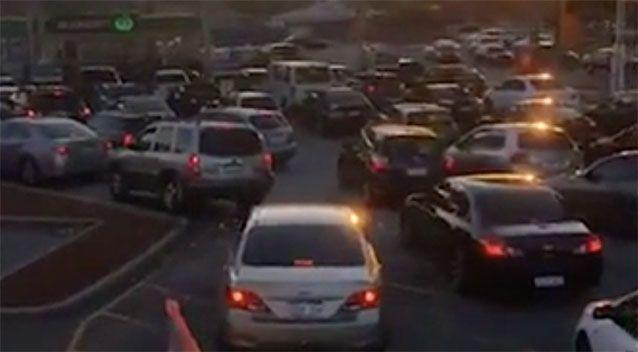 Motorists queued more than an hour to get cheap petrol. Source: 7 News