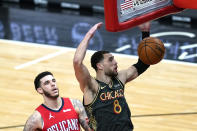 Chicago Bulls' Zach LaVine dunks past New Orleans Pelicans' Lonzo Ball during the first half of an NBA basketball game Wednesday, Feb. 10, 2021, in Chicago. (AP Photo/Charles Rex Arbogast)